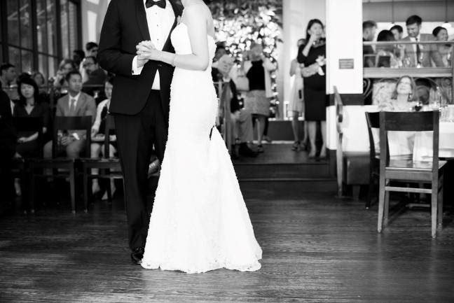 Black and white photo of bride and groom dancing captured by Red Fish Blue Fish Photography