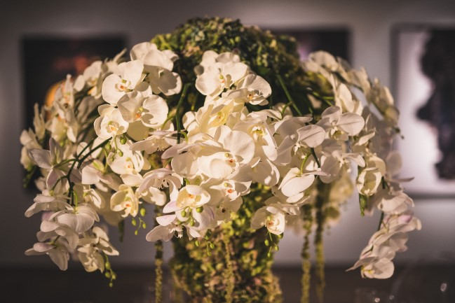 Large wedding reception floral center piece made from white orchids