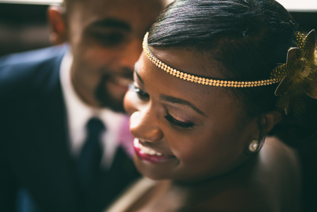 Bride wearing a gold hairband with over sized flower