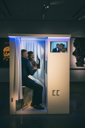 Bride and groom in a photo booth rented from Triad DJ & Events
