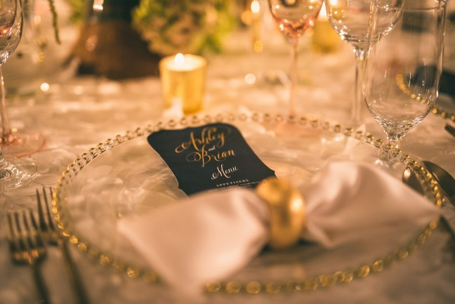 Gold and clear glass place setting with Wedding Paper Divas reception menu