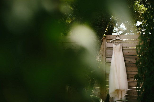 Sweetheart neckline wedding dress hanging from fence