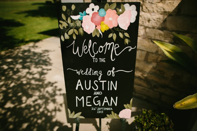 Black wood wedding signs with bright colored flowers and white writting