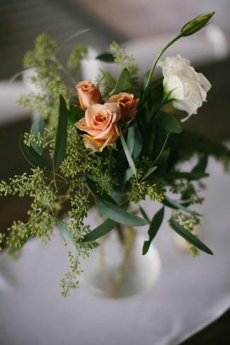 pink roses with seeded eucalyptus for wedding reception center piece
