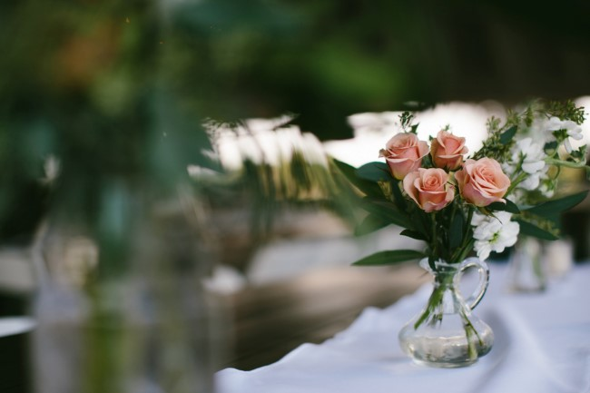 Tight pink roses in clear glass jug