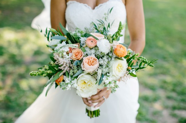 White and peach peonies with greenery for bridal bouquet