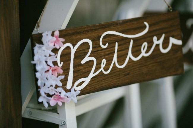 Wooden wedding sign with flowers that says Better