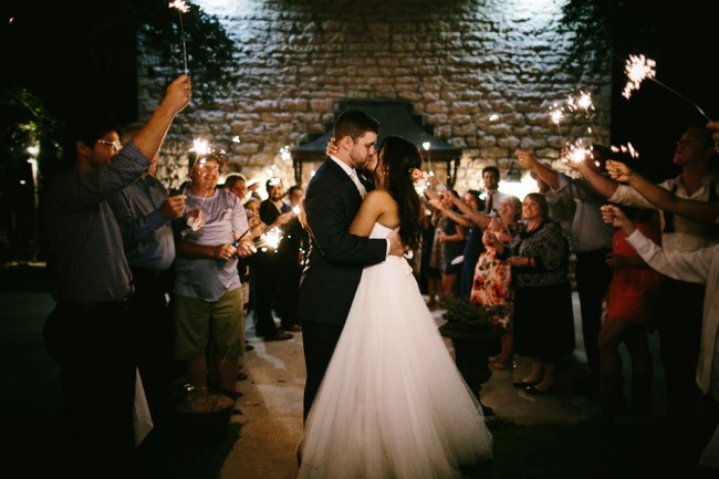 Bride and groom departing their wedding with sparklers