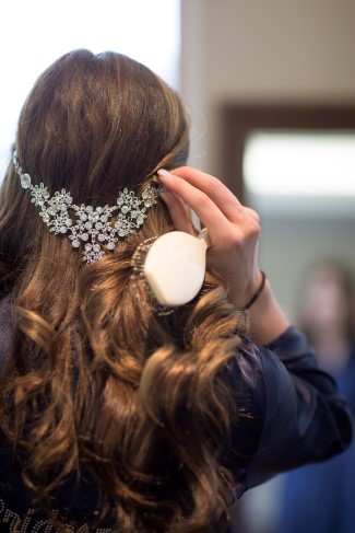 Bride wearing a rhinestone head piece in her hair