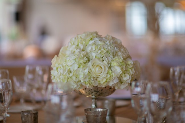 White roses and hydrangeas in silver bowl