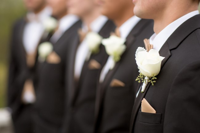 Groomsmen wearing black suits and white boutonnieres