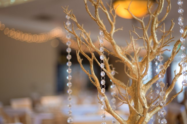 Gold Manzanita Tree with crystals hanging from it for wedding reception decor