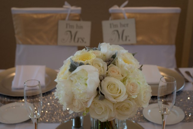 Silver glitter table runner with gold accents and white roses for wedidng reception designed by A'Reve Event Production