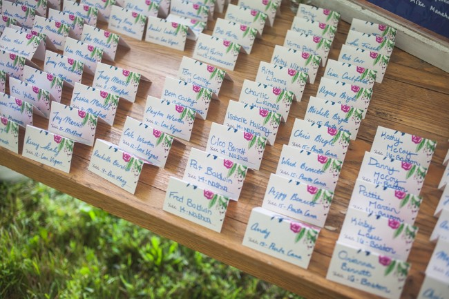 Wedding reception escort cards with pink roses