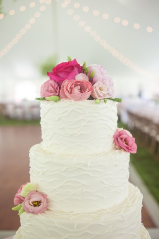 Round white wedding cake with pink roses created by Creative Cakes by Debby