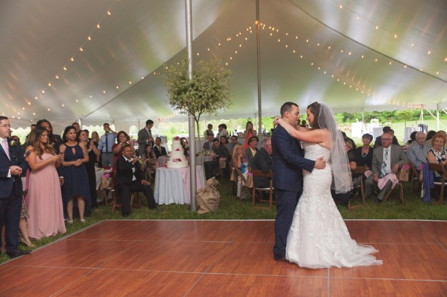 Bride and groom dancing under a tent captured by HilaryColleen Photography