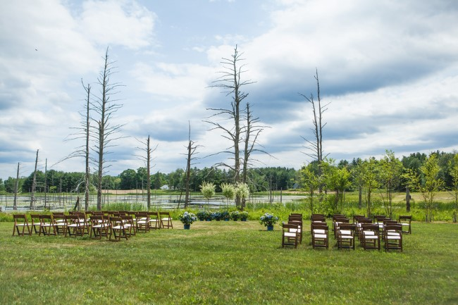 Outdoor back yard wedding in front of a lake
