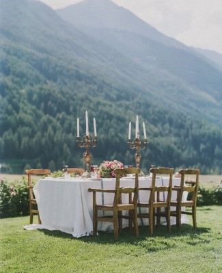 Long rectangle table with gold candelabras and pink floral center pieces