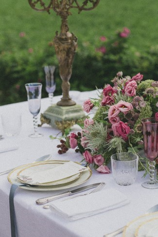 Gold candelabras with a bouquet of Thistles and pink roses created by Le jardin d'Amelie for wedding