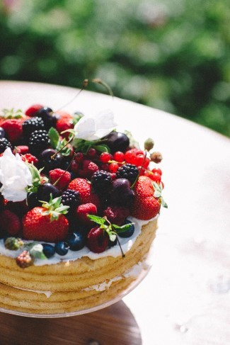 Naked cake covered with berries