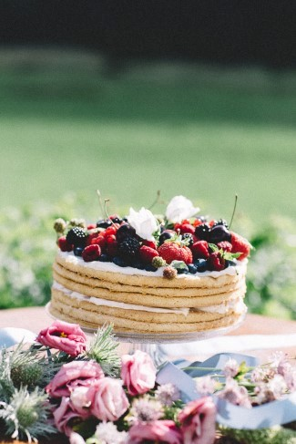 pancake naked cake covered with berries for wedding reception