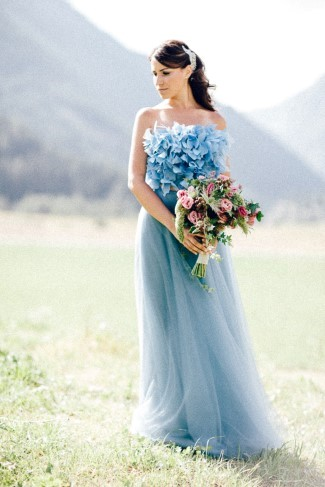 Bride holding bouquet by Le jardin d'Amelie standing in a field