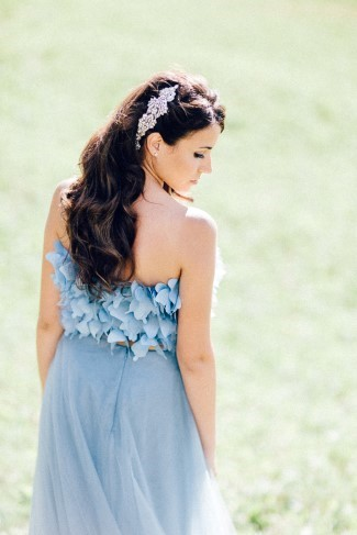 bride wearing blue gown with rhinestone hair clip