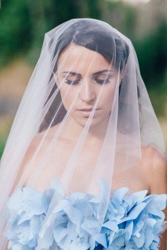 Bride wearing a drop veil and blue gown