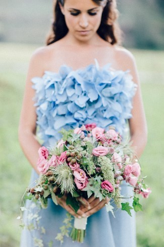 Bride holding pink and green bouquet created by Le jardin d'Amelie
