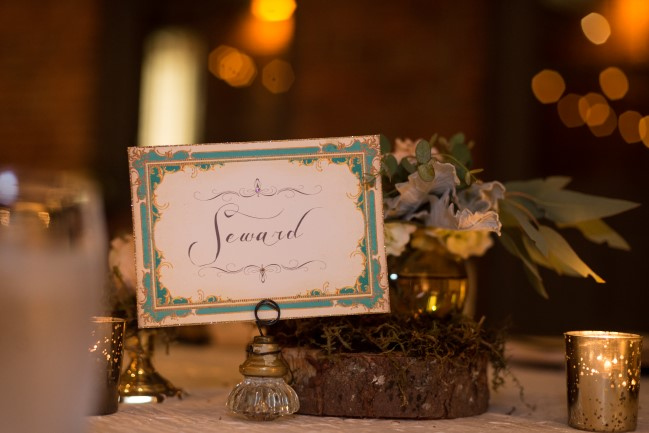 Ornate vintage table number for wedding reception