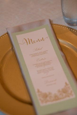 Mint green wedding reception menu on a gold charger for wedding reception designed by Manette Gracie Events