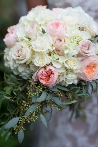 Bridal bouquet created by Geneva Diane Designs with white roses, hydrangeas and pink peonies and roses.