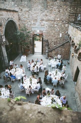 Open air tuscan themed wedding reception in castle at Castello di Vincigliata