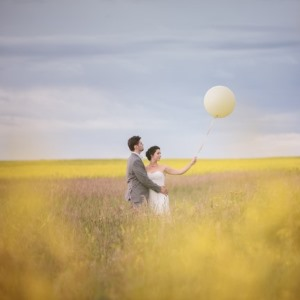 bride and groom with big balloon