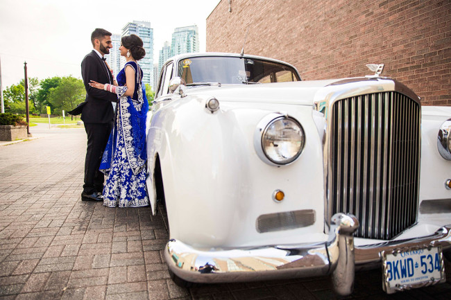 Sikh wedding couple next to white vintage car