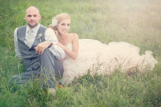 Bride and groom sitting in the lawn captured by One-12 Photography