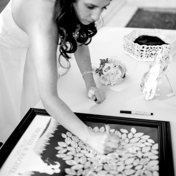 Bride signing a PaperRamma Guest book Tree