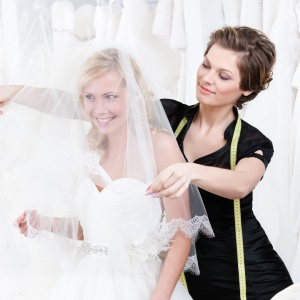 Bride trying on a veil at a wedding shop