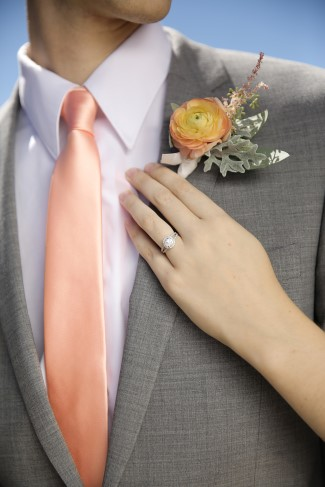 salmon pink necktie with grey suit