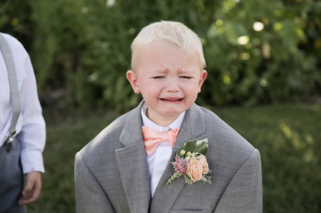 young boy in suit jacket crying