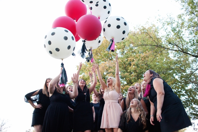bachelorette party with giant pink balloons