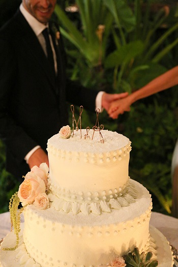 2 tier white cake with bride and groom initial wire cake topper