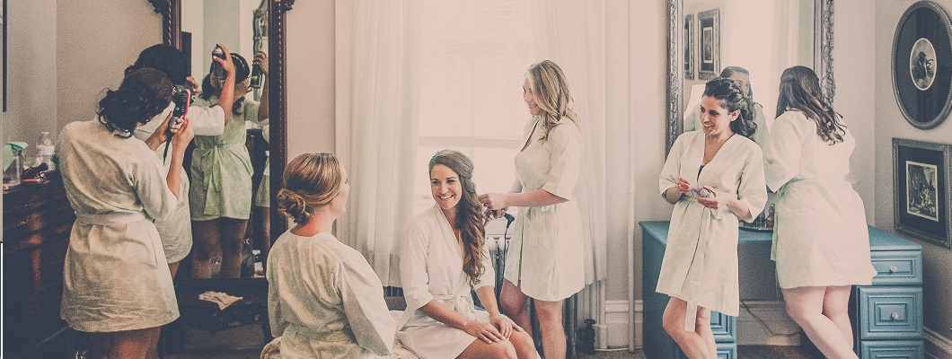 Bride and bridesmaids getting ready in silk robes