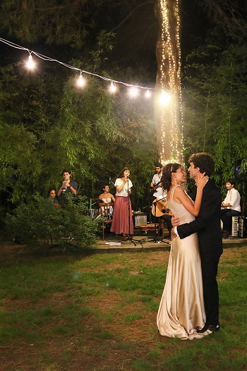 Bride and groom dancing at outdoor wedding reception at Vivai Le Mura