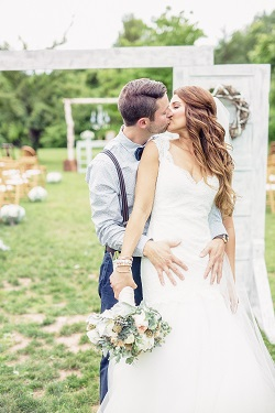 Bride and groom kissing captured by dp Studio