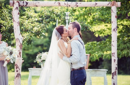 Bride and groom kissing during outdoor ceremony at Jack's barn in Oxford New Jersey