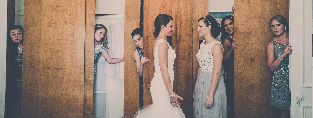 Bride looking at bridemaids coming out of the cuboard captured by dp Studio