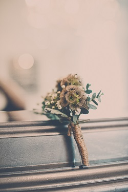 Eucalyptus and baby's breath Boutonniere