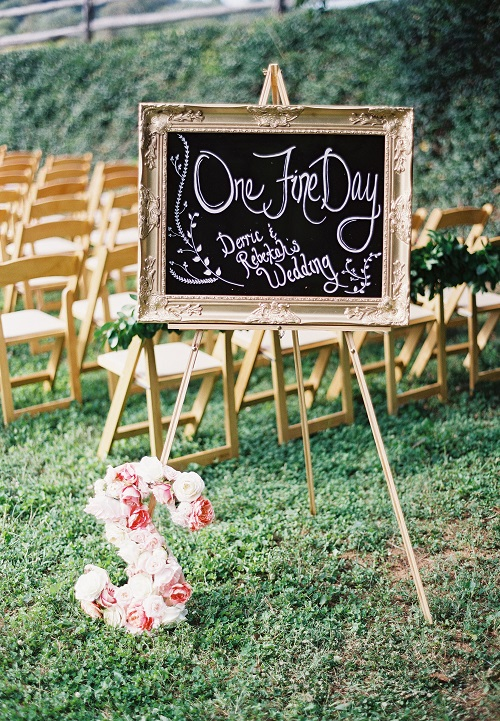 Gold ornate sign for wedding ceremony decor