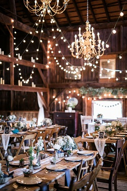 Indoor rustic wedding reception at Jack's Barn